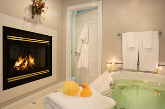 Bathroom at Stone Hill Inn featuring luxury spa tub for two