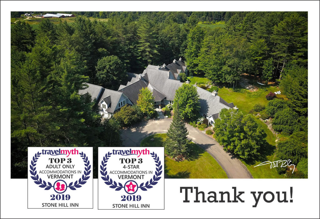 Stone Hill Inn from above, showing two awards for Adult Only and Best 4 Star Accommodations in Vermont